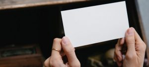Woman holding an empty card