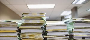 Paperwork packed and stacked on the table