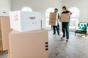 two men holding boxes